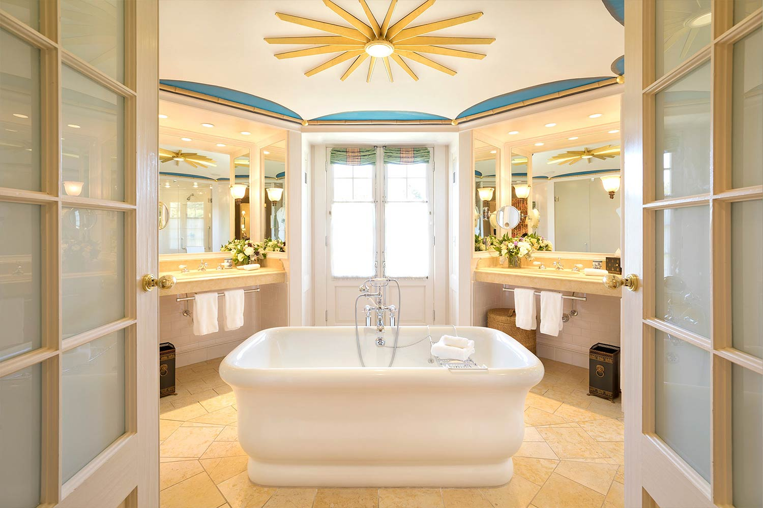 The spa like bathroom of Room 16 featuring a soaking tub in the middle of a spacious, hexagonal room.