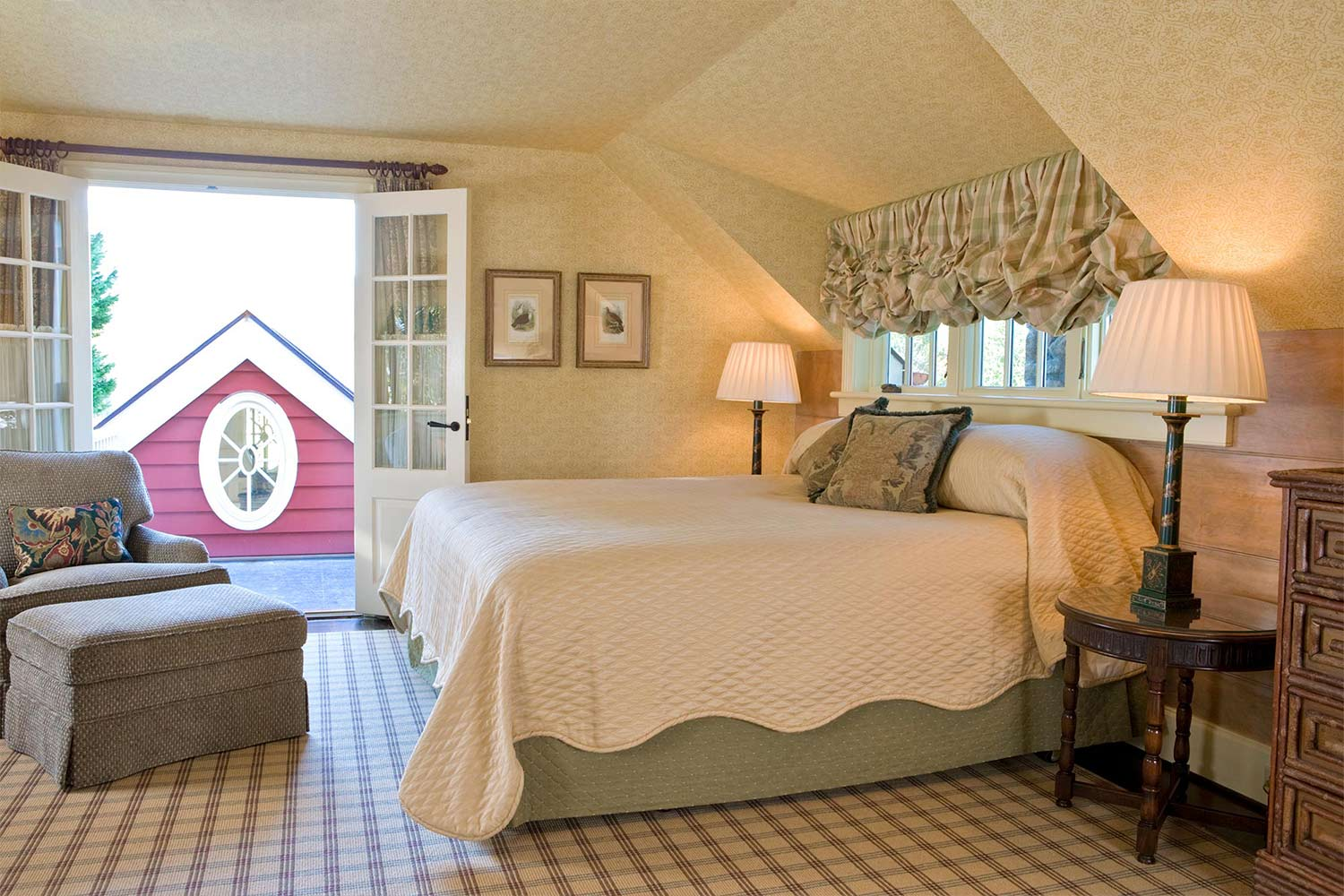 A second floor master bedroom with an open window and inviting bed,
