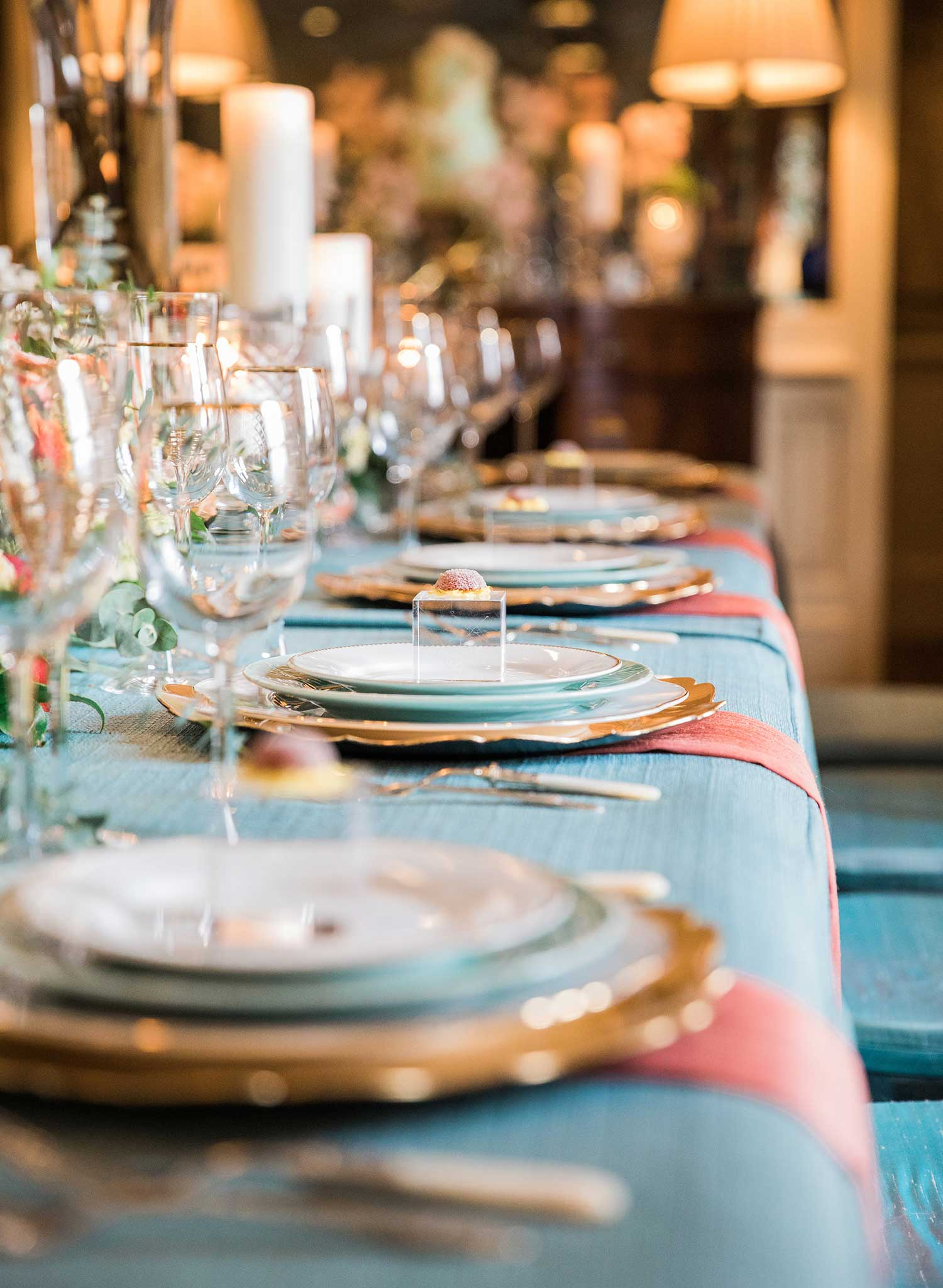 A table set for a small wedding with a blue table cloth.