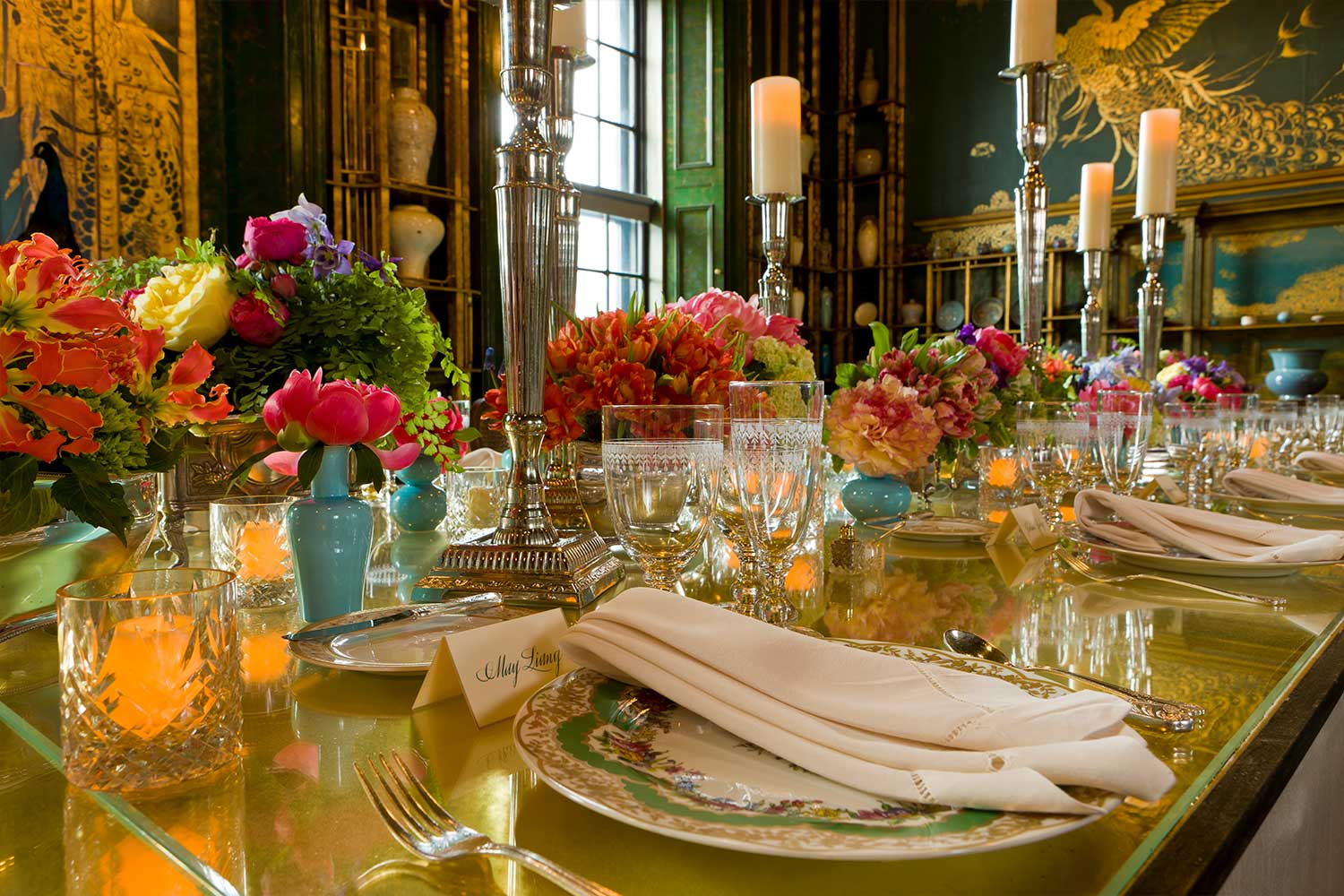 A lavish and colorful table set for an elegant party.