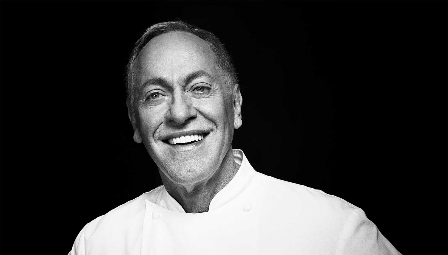 A black and white headshot of Chef Patrick O'Connell, smiling.