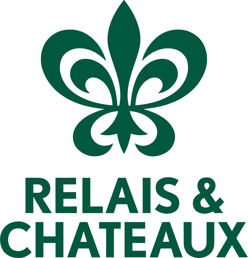 A green graphic of the Relais & Chateaux logo.