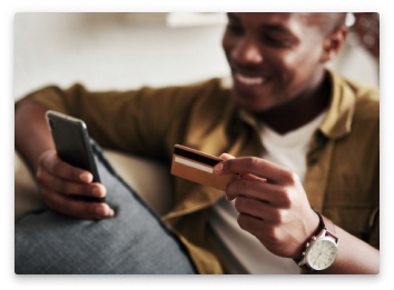 A man with his debit card and smartphone.