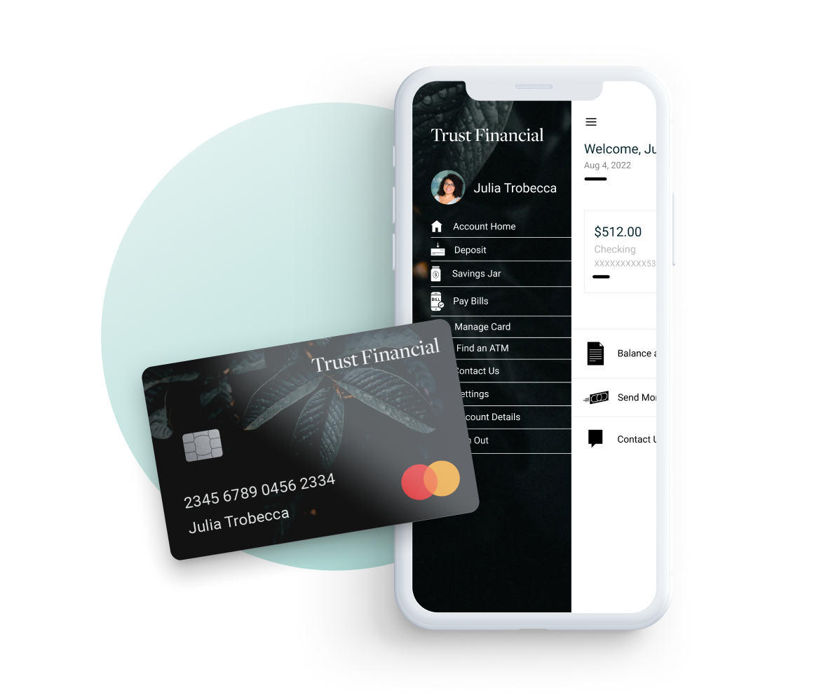 A debit card with a smartphone banking app open.