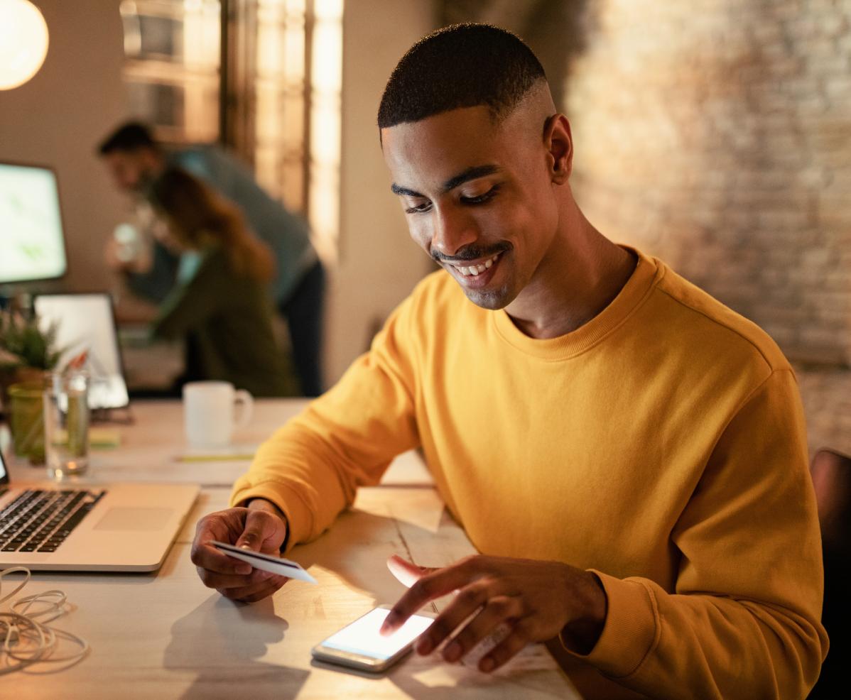 A man looking at his phone at a startup.