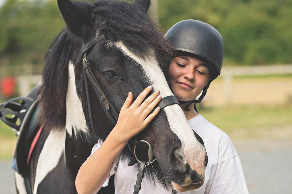 Horse Riding Smiling Girl