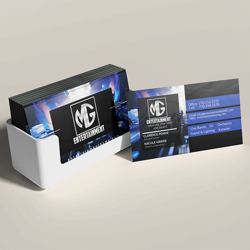 Business cards in white card holder on grey background