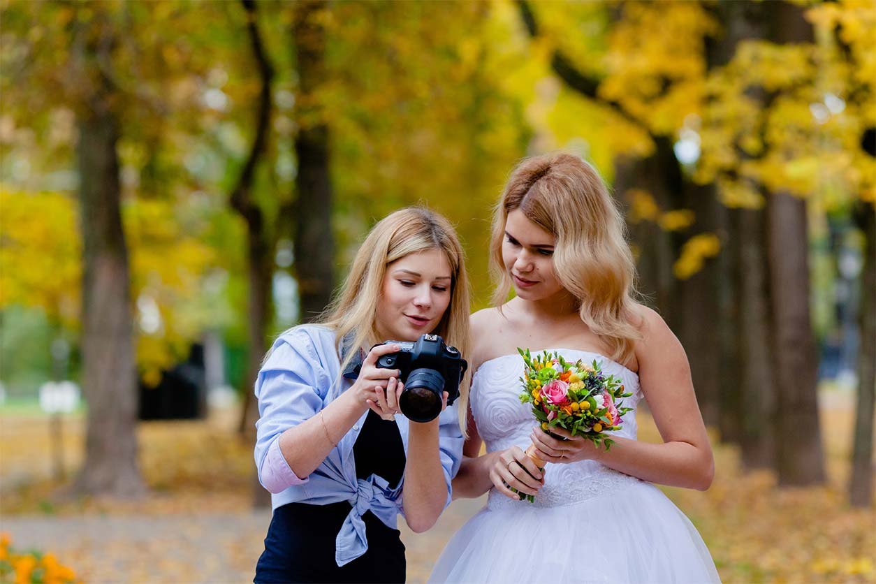 How to become a freelance photographer - Crunch - image a of a photographer at a wedding