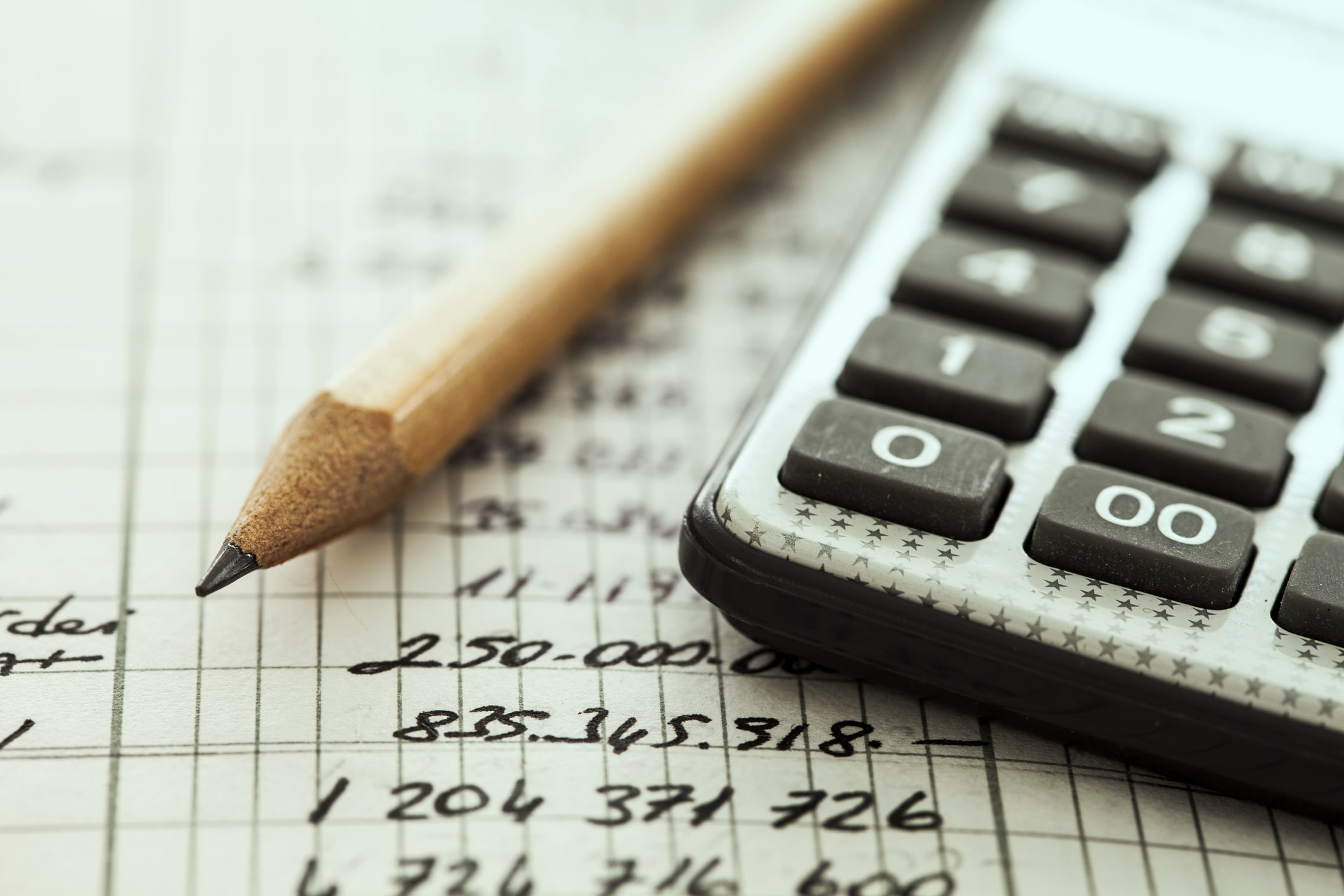 The Crunch Personal Tax Estimator, image of a pencil and calculator | Crunch