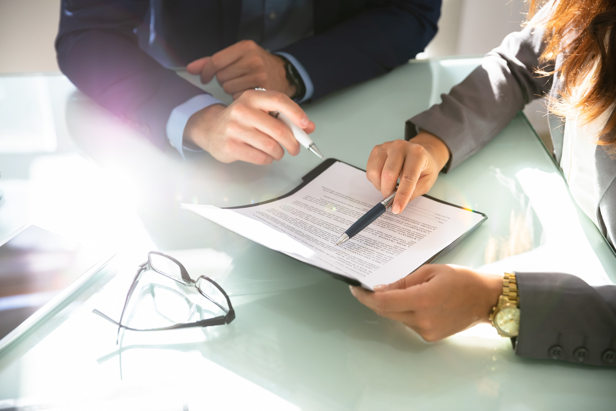 What do recruiters need to know about IR35? - Image of two recruiters with a contract