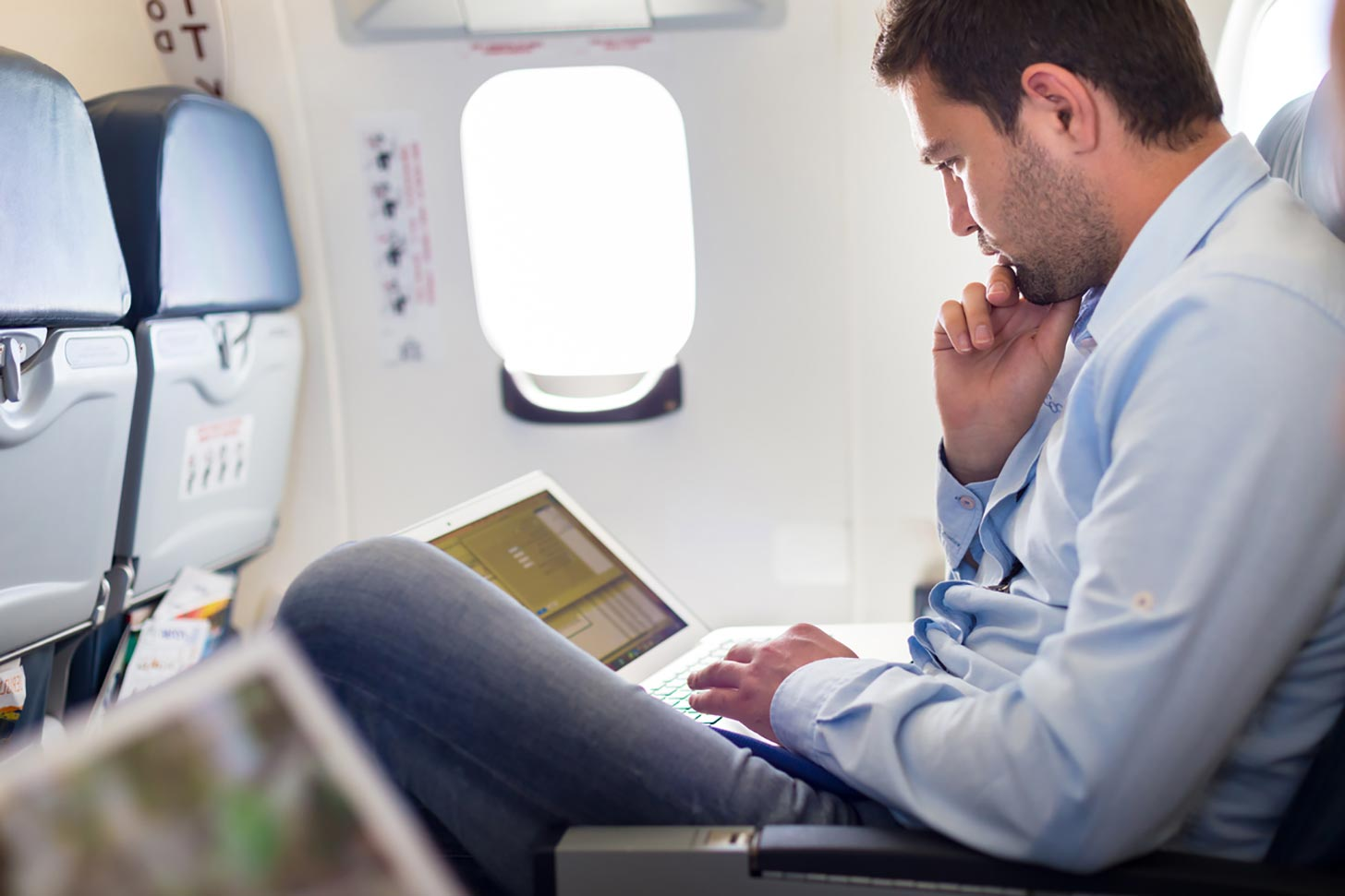 Am I a UK Tax Resident - Crunch - image of a man on a plane