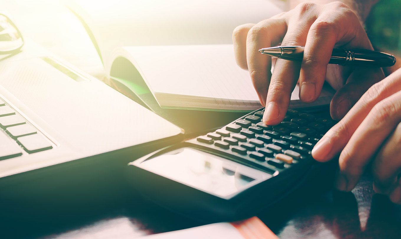 Dividends - What Are They and What Taxes Do I Pay on Them? Image of someone working on a tablet | Crunch