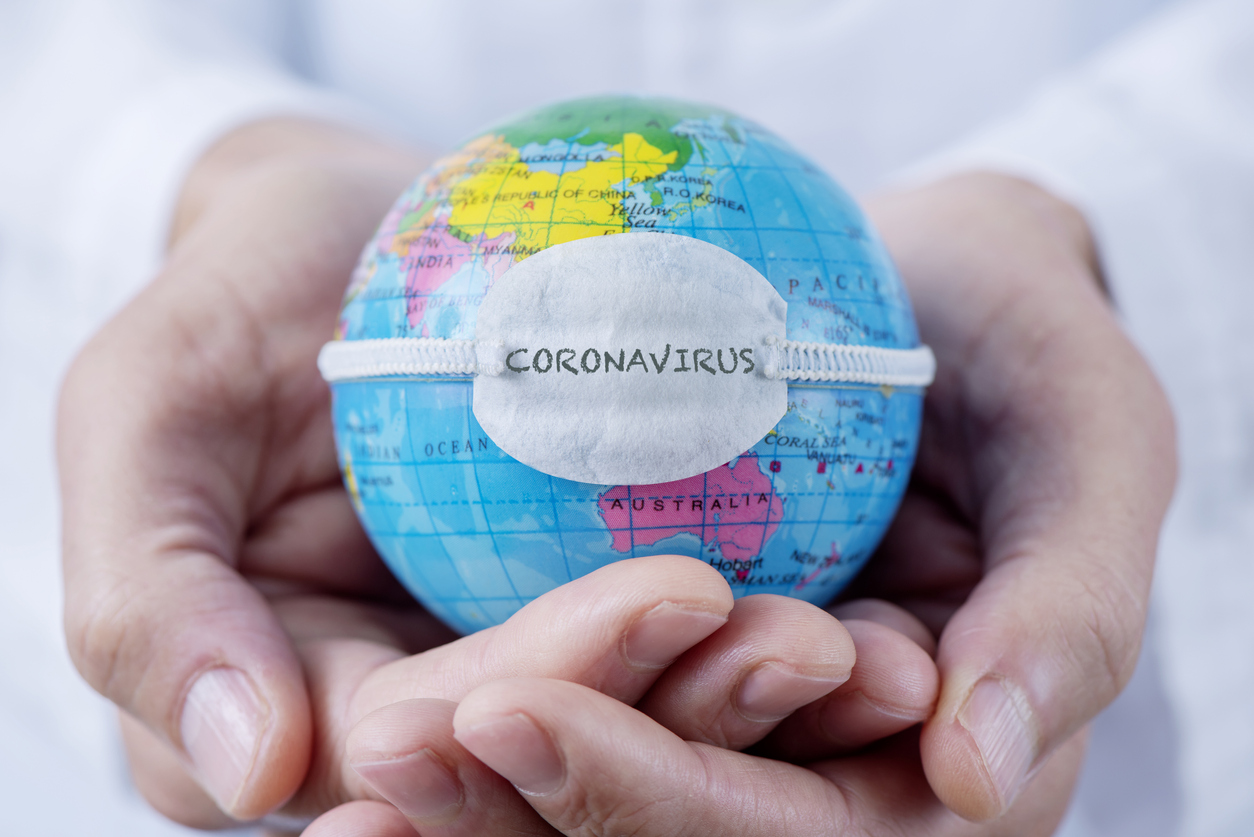 What help is available for small businesses, gig workers, and the self-employed affected by coronavirus (COVID-19)?, image of a globe with a mask | Crunch