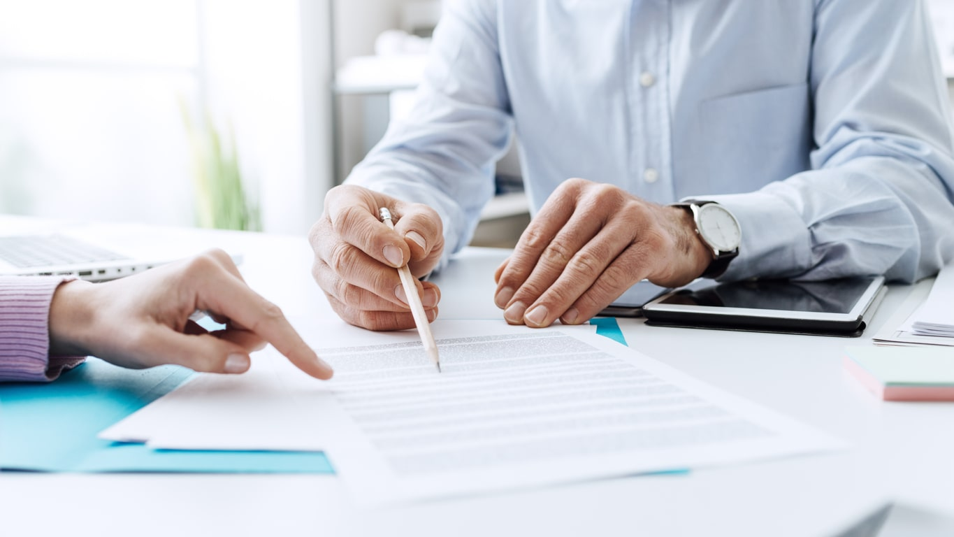 IR35: Why contractors should have business insurance, image of someone signing insurance terms