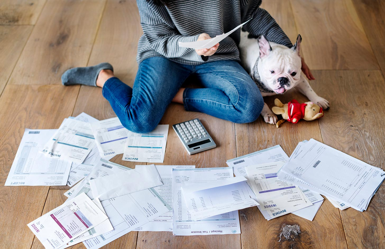 Do I have to complete a Self Assessment tax return?, image of a woman reviewing notes with a dog | Crunch