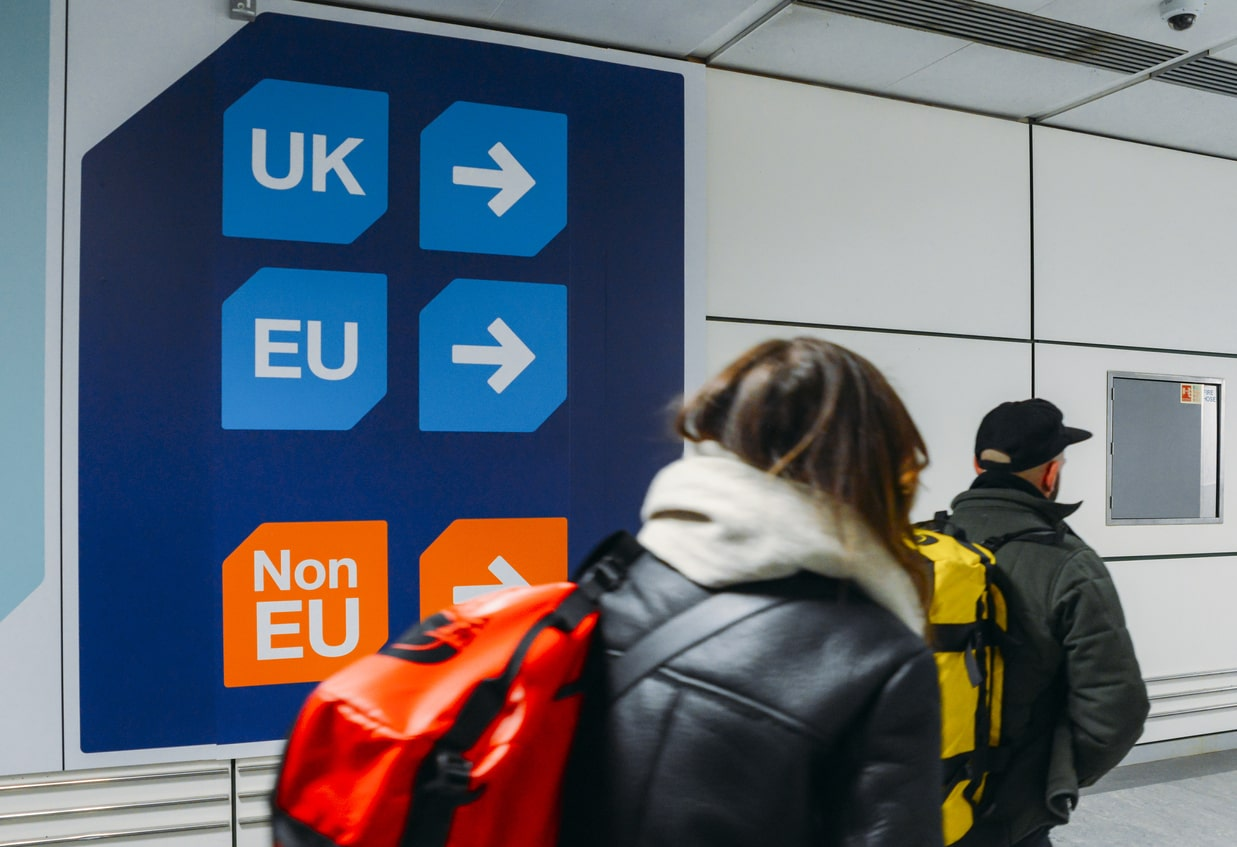 Immigration Guide - How can employers recruit people from outside the UK from 1 January 2021, image of people at the airport | Crunch