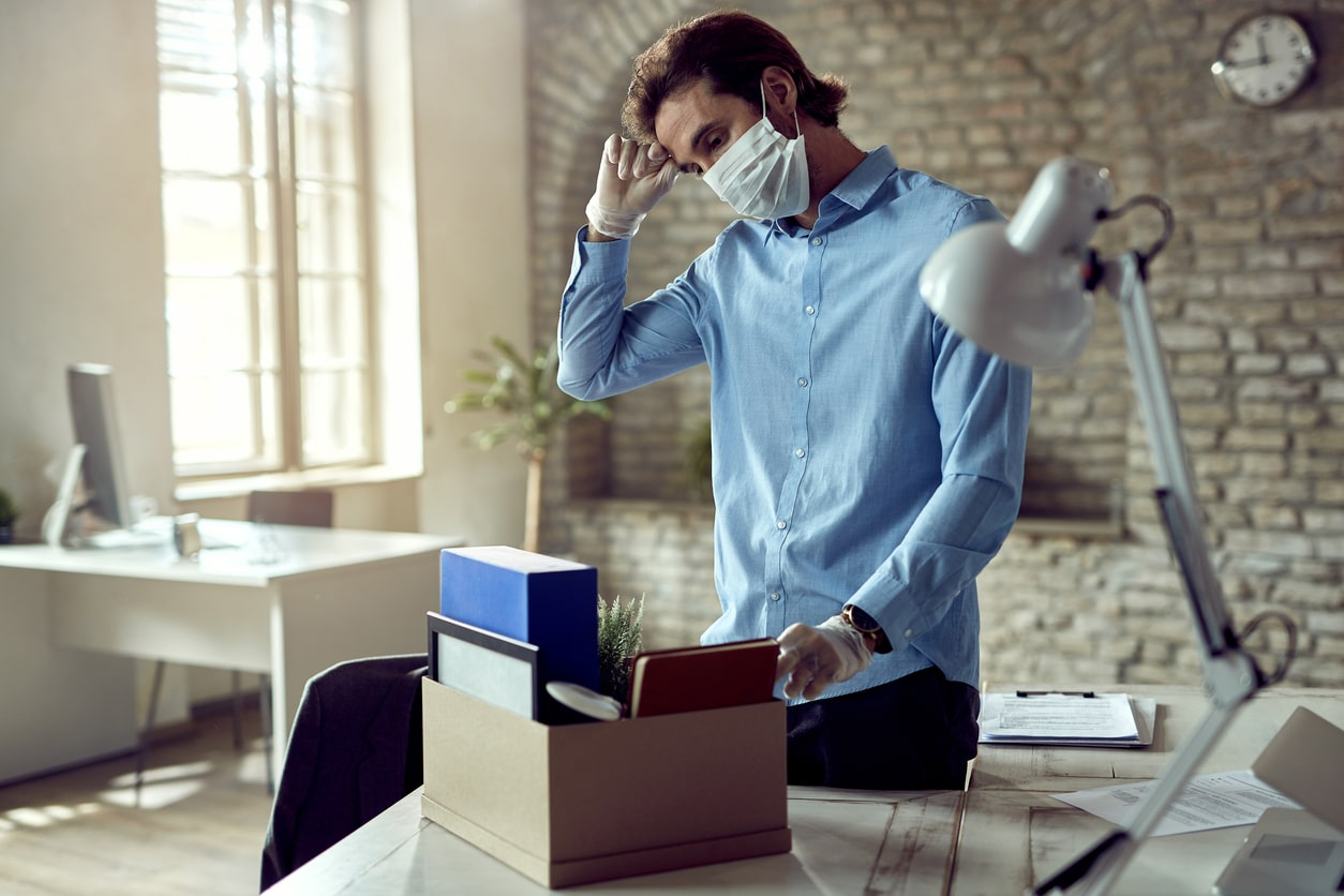 What to do if you're being made redundant because of COVID-19, image of someone clearing their desk | Crunch