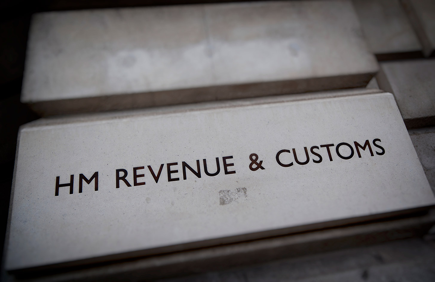 What is an Earlier Year Corrections (EYC)?, image of HMRC logo on a brick wall | Crunch