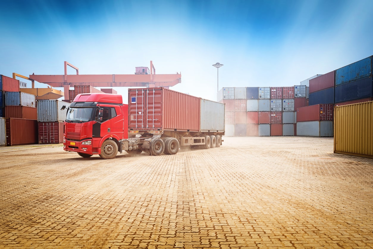 Hours and rest breaks for UK goods vehicle drivers - Part 1. Image of a goods lorry at the port