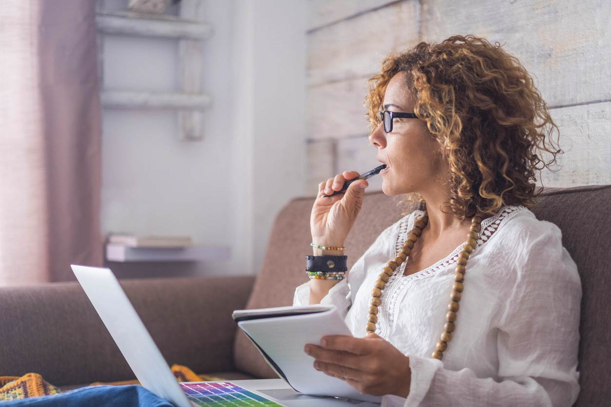 How to become a consultant, image of a woman at a laptop   Crunch