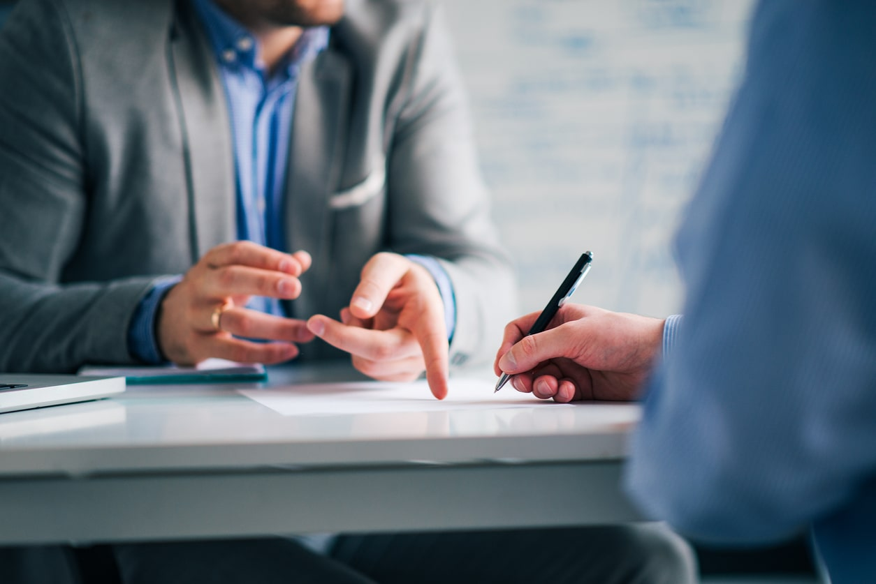 Confidential pre-termination negotiations and Settlement Agreements. Image of people discussing contract terms