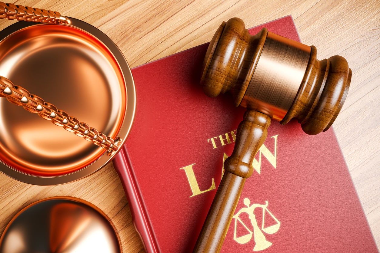 Employment Tribunals – your rights. Image of a gavel and scales. | Crunch