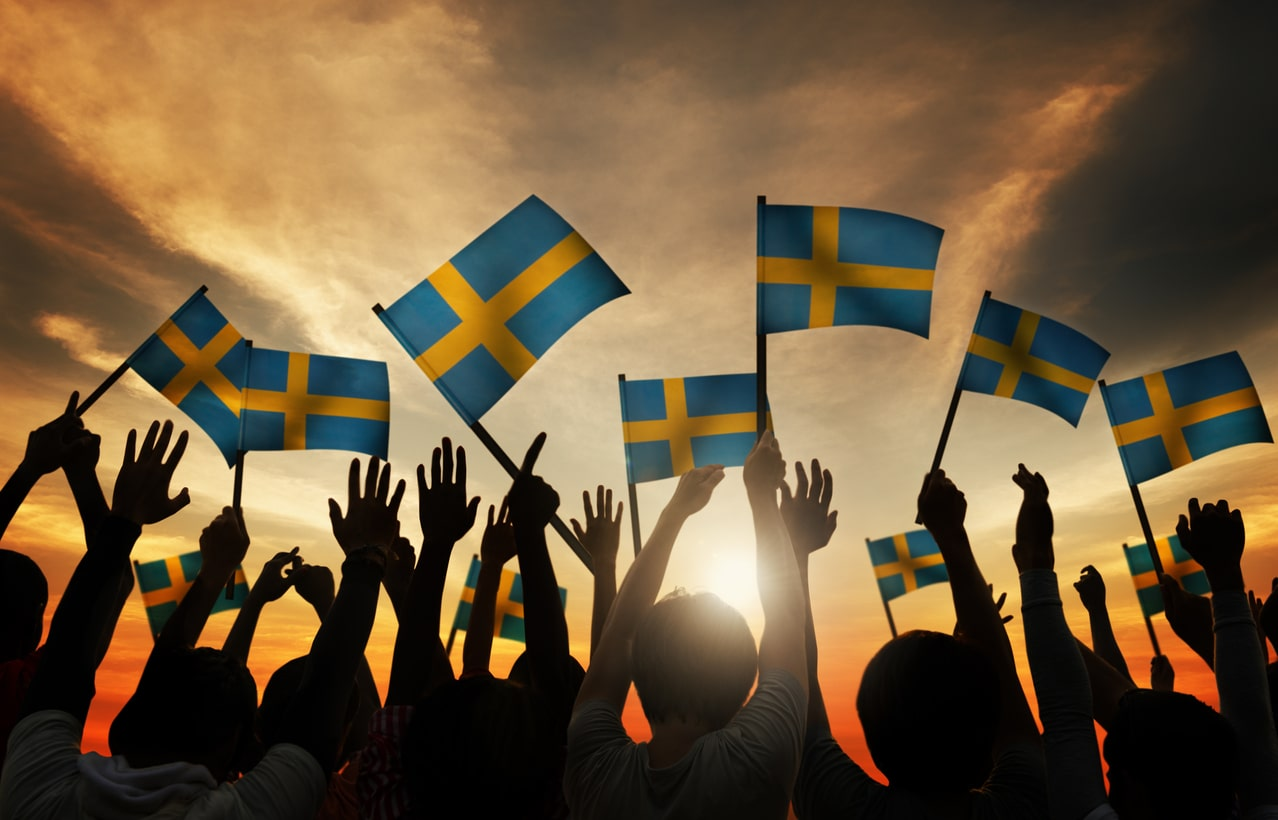 The Swedish Derogation Model – what is it? Image of Swedish flags