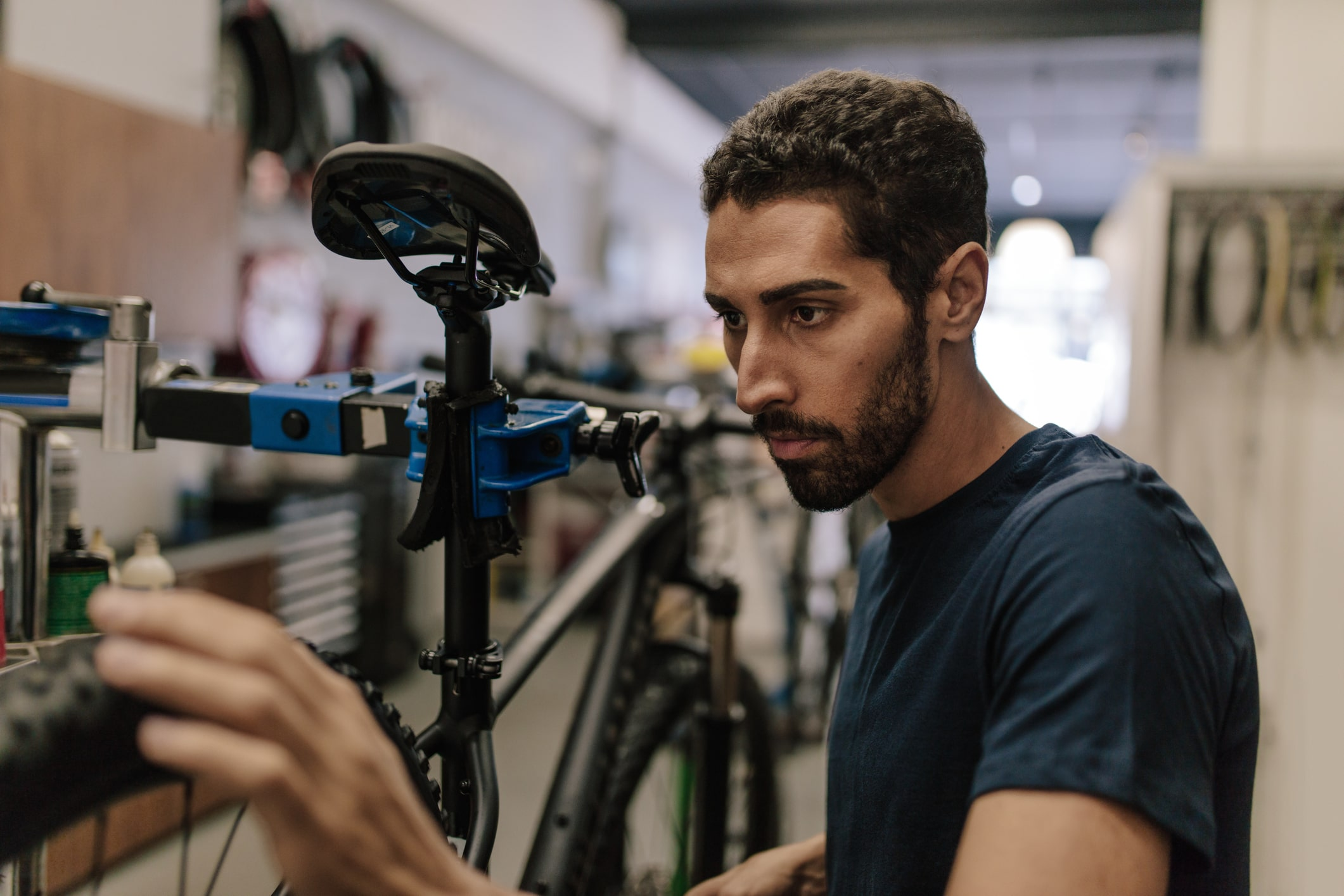 What is Financial Reporting Standard (FRS) 105?, image of mechanic repairing a bike | Crunch