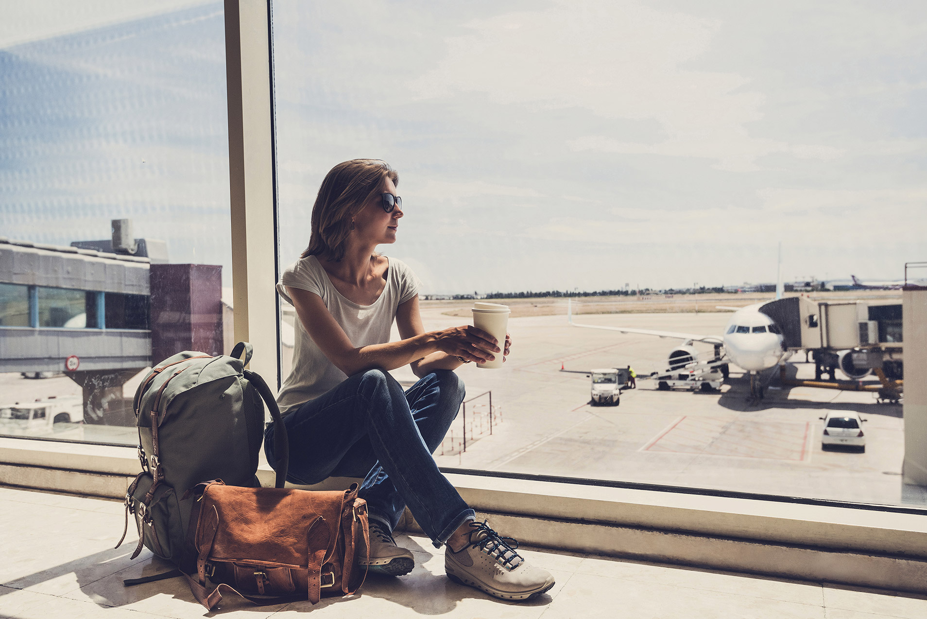 Foreign business travel: expenses and allowances explained - Crunch - Picture of a woman waiting for a plane.