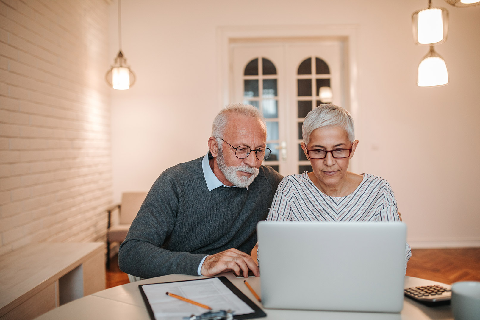 What are the tax implications of closing your limited company?, image of pensioners on a laptop | Crunch