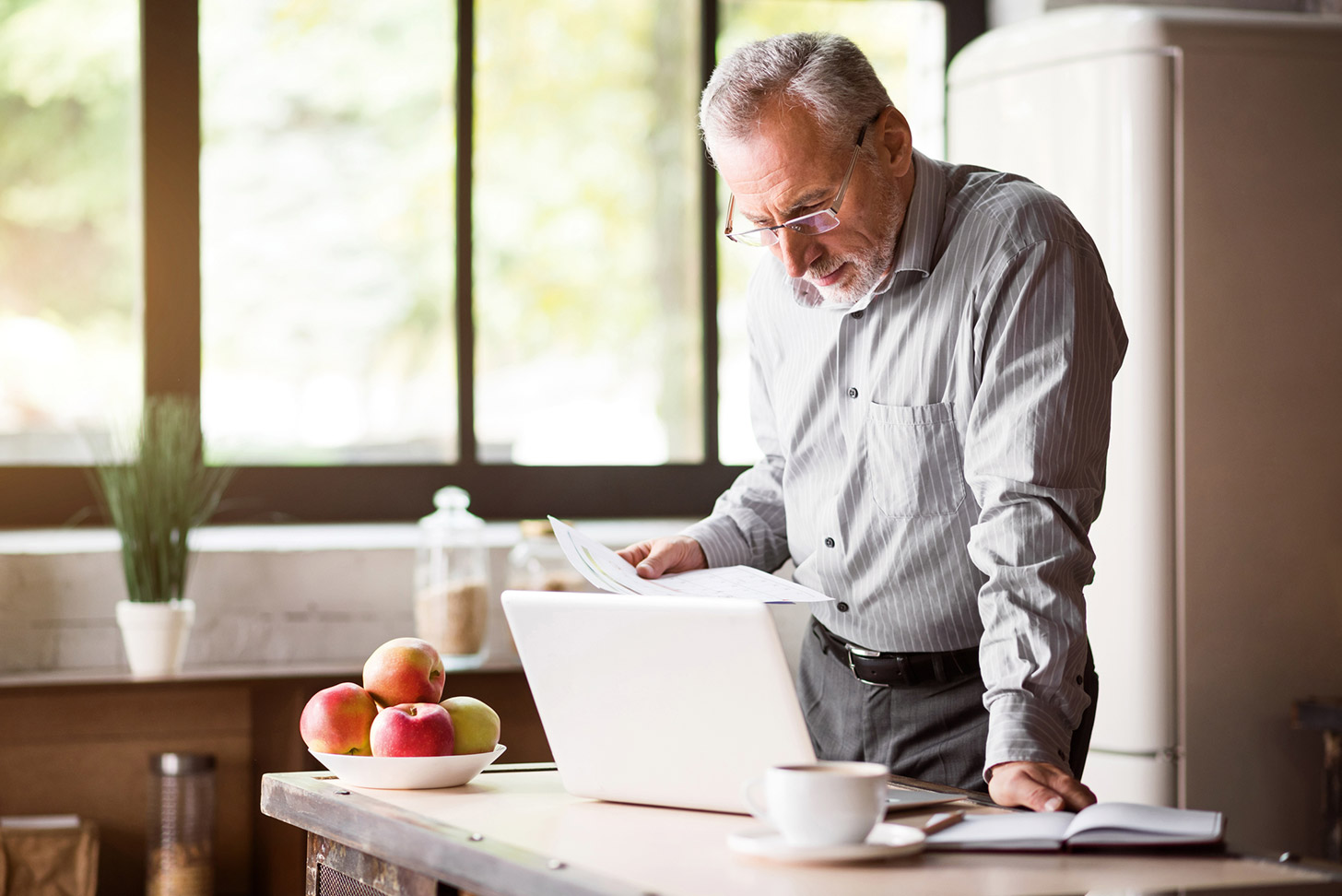Retired man at a laptop