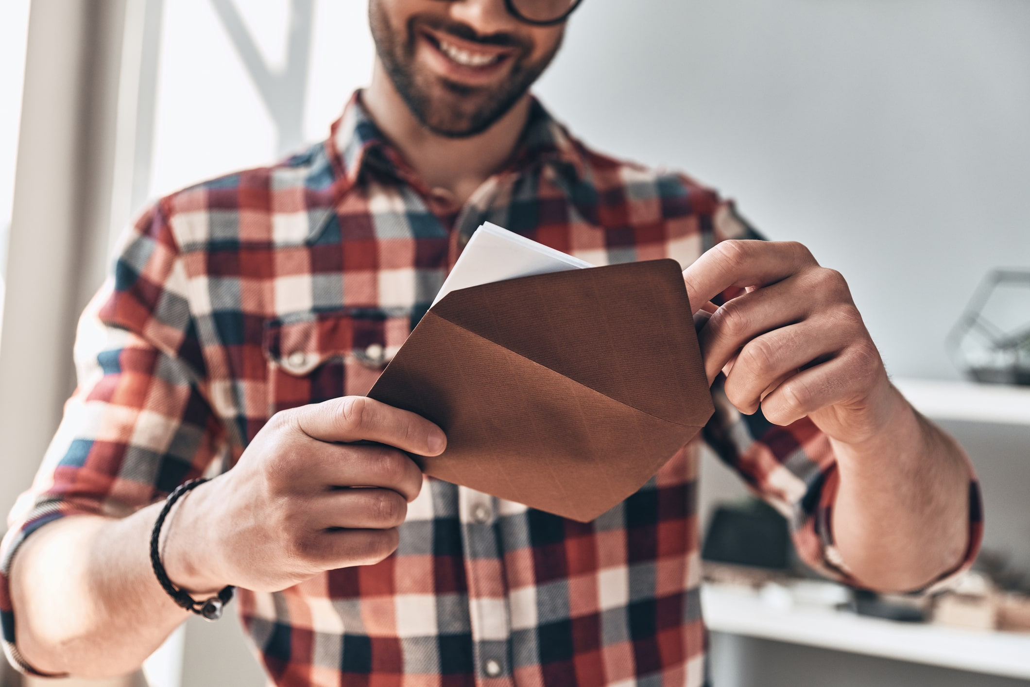 Man opening a letter