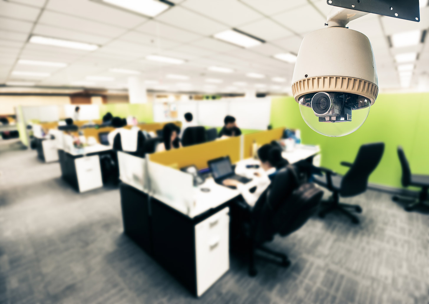 Can your employer spy on you? Image of a security camera in an office | Crunch
