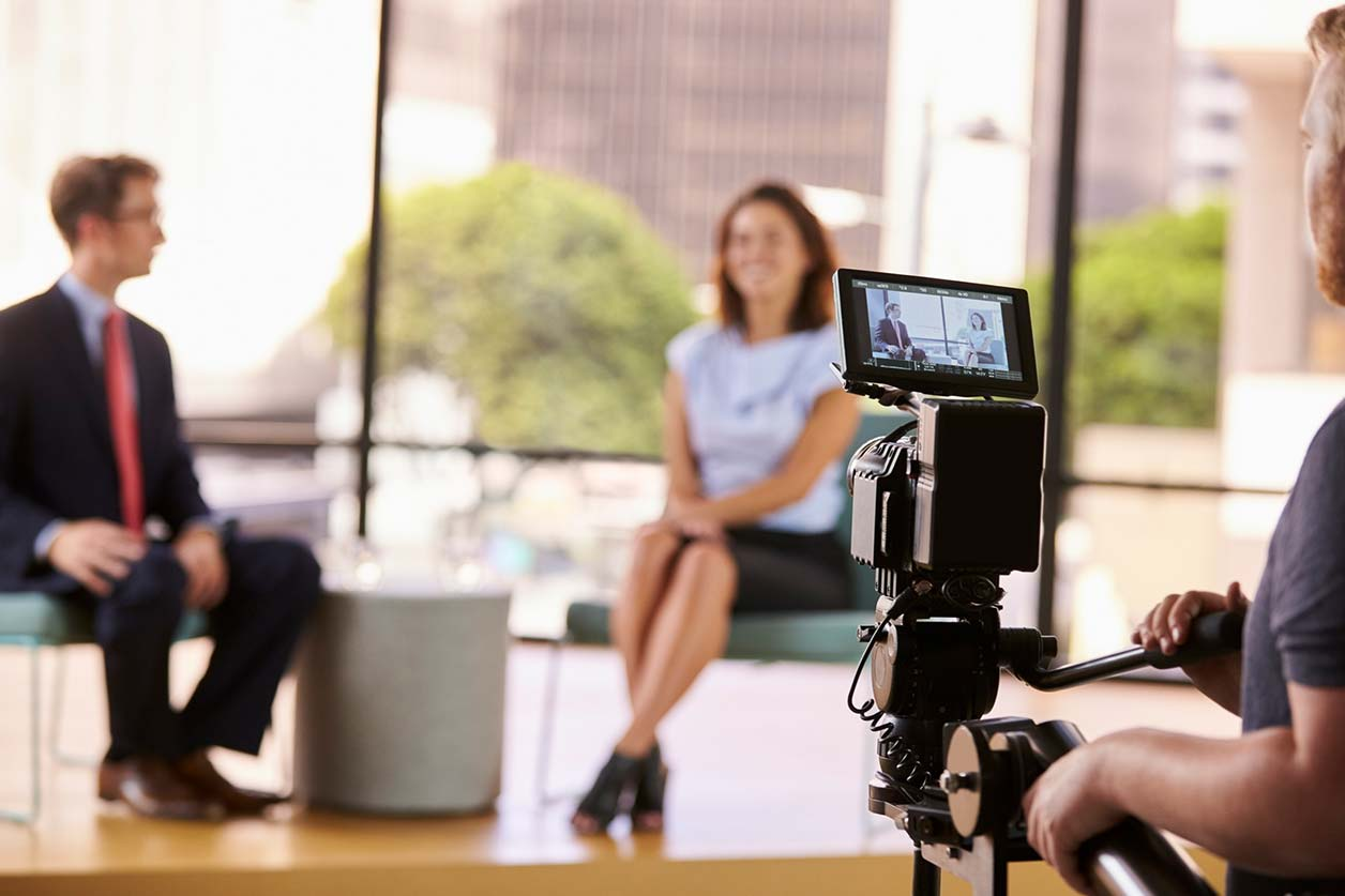 Tax reliefs available for creative industry workers, image of a camera filming two presenters | Crunch