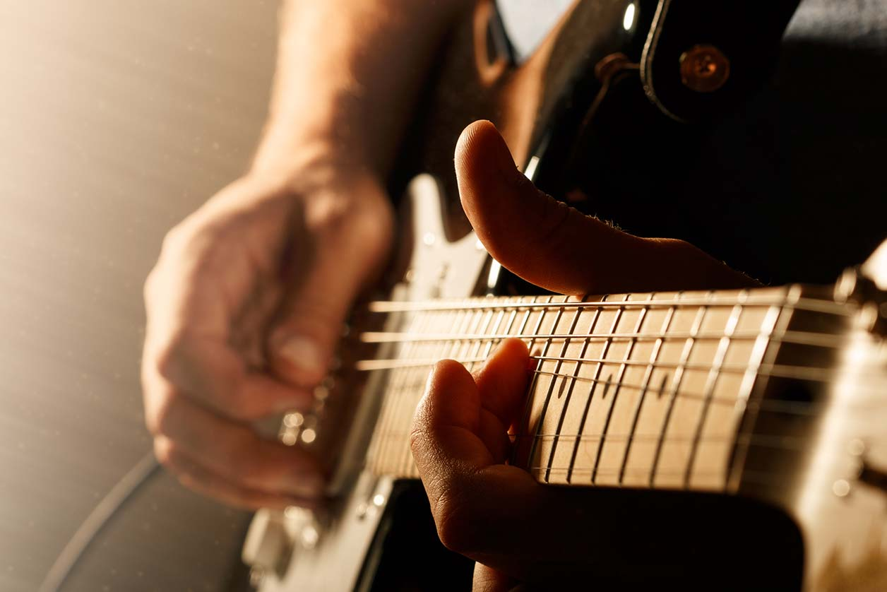 Can musicians make a living off Spotify?, image of a guitar   Crunch
