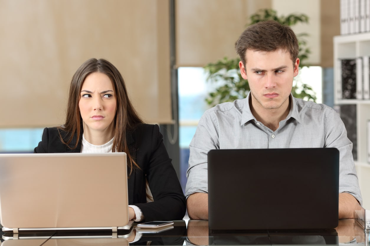 Grievance Procedures. Image of two employees with a problem
