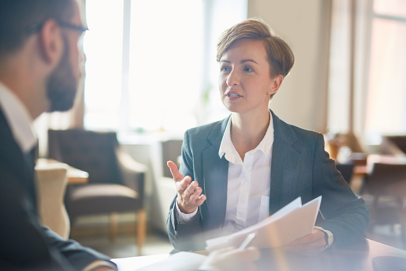 Cracking the recruiter's code: what they say, and what they actually mean, image of recruiter talking to client   Crunch