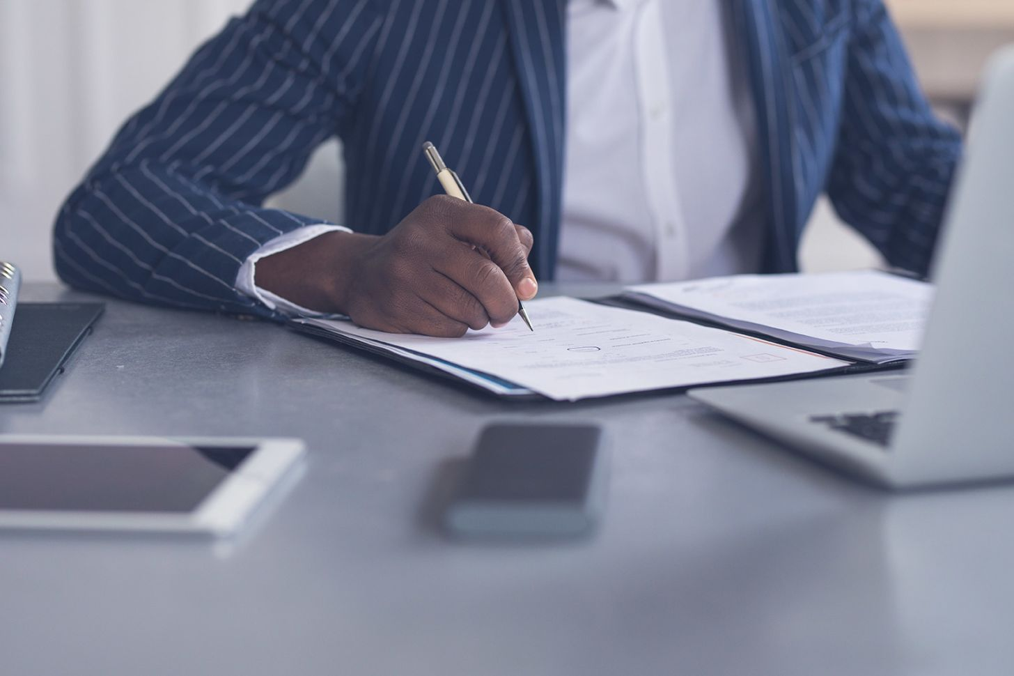 What are your rights if a client cancels your contract?, image of someone writing at a desk | Crunch