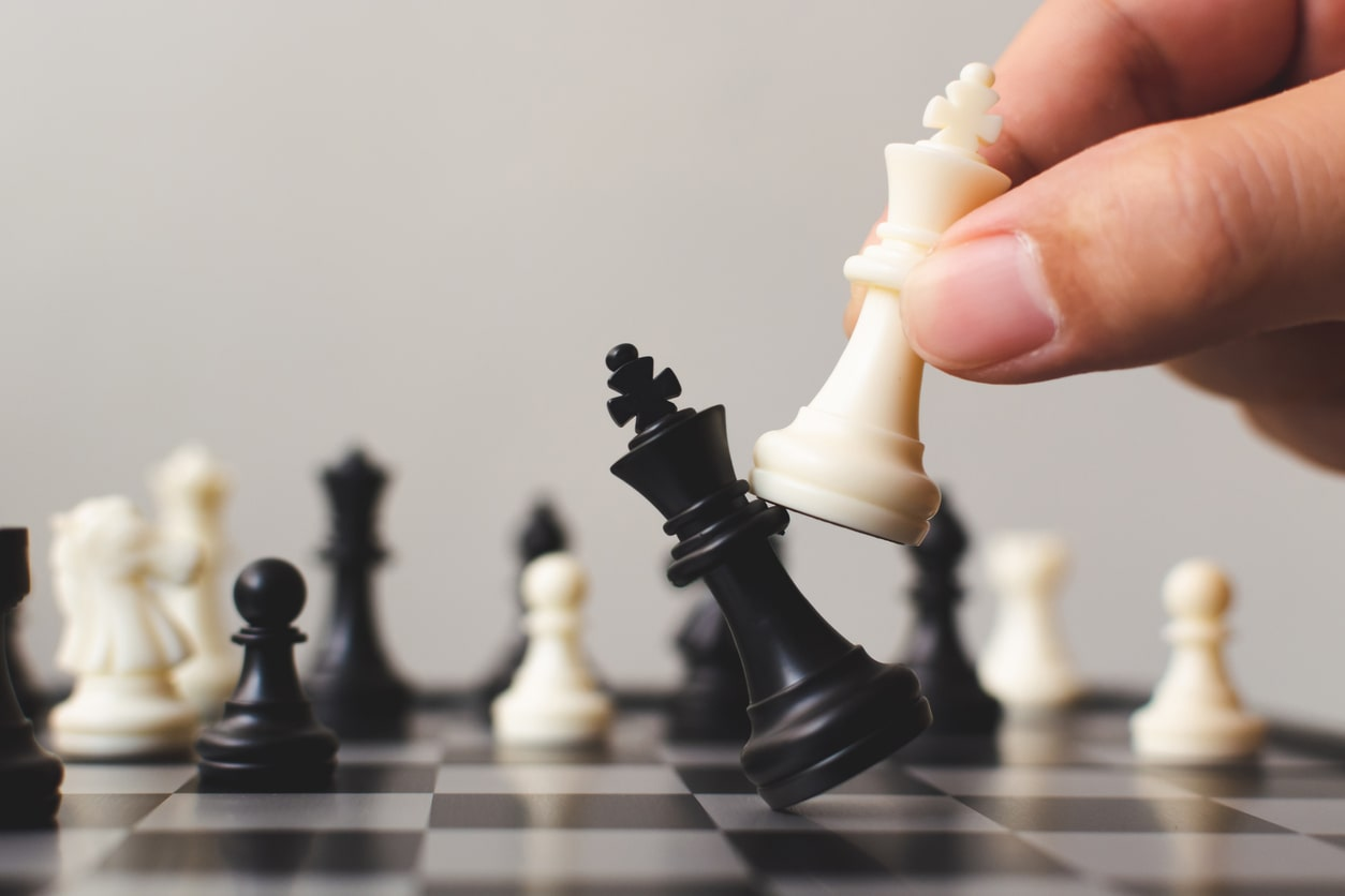 QuickBooks vs. Xero vs. Crunch: which is better?, image of someone toppling a king in chess | Crunch