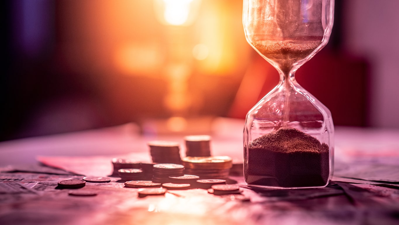 HMRC & Companies House late filing & payment penalties for 2021/22, image of an hourglass beside money | Crunch