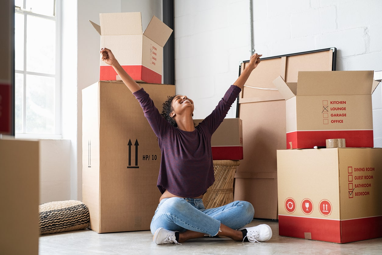 Unlocking mortgage lending after lockdown, image of a happy new homeowner | Crunch