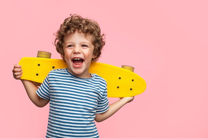 What is Child Benefit - Crunch. Image of a happy child with a skateboard.