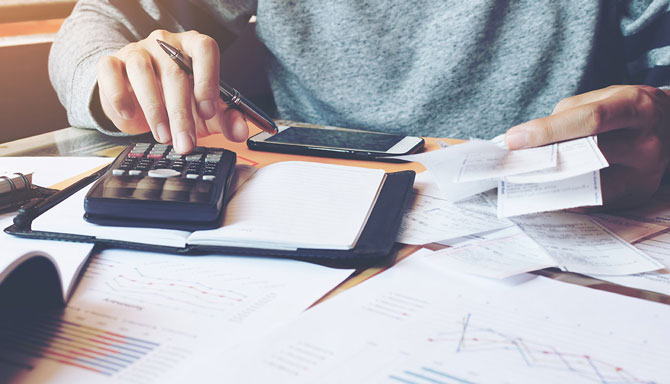 What is bookkeeping and why does it matter - Crunch - picture of man doing some bookkeeping