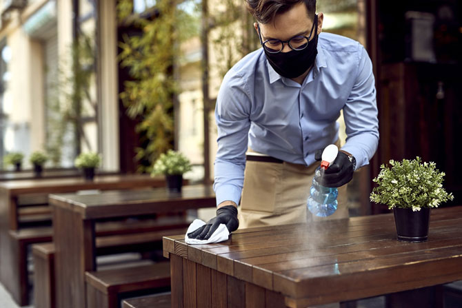 Crunch's guide to the new government Job Support Scheme   Crunch - Image of a waiter sanitising a table