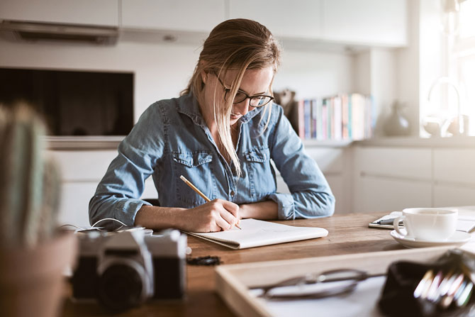 How to get the best CV or portfolio, image of someone working at a desk   Crunch