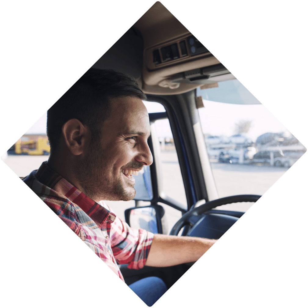 Young happy man driving a truck