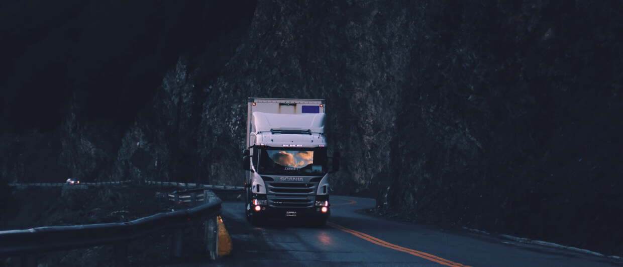 A truck driving on a mountain road