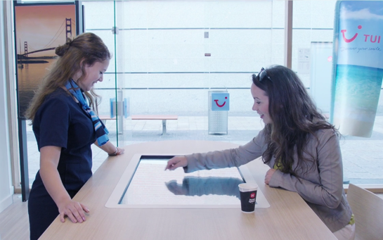 Interactive experience in a TUI Group agency, made by First Impression Audiovisuel with Intuiface