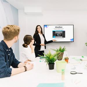 Woman introducing Presentation in Meeting room