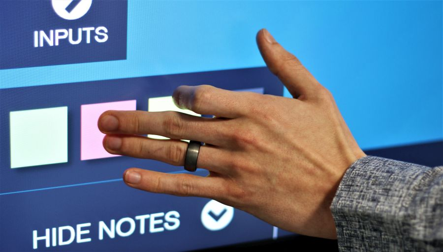 Left hand of a man using a touchscreen software solution